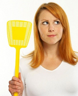 Girl with fly swatter
